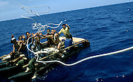 Hungry and tired, Cuban rafters were ready to be towed back to Havana by an American yachtsman when he found them floating eight miles off the Cuban coast. They had been floating in the Florida Straits for five days. In the summer of 1994 Cubans once again began taking to the water, attempting to escape the oppression of Fidel Castro's government. Many tried, but few made the treacherous journey across the Florida Straights. (Photo © Jock Fistick)
