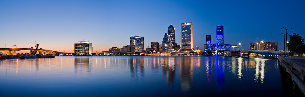 Downtown Jacksonville waterfront at twilight showing The Main Street Bridge bridge (John T Alsop Jr. Bridge) crossing the St. Johns River and cetral city ofiice buildings.