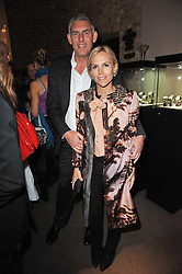 Designer TORY BURCH and LYOR COHEN the North American Chairman and CEO of Recorded Music for Warner Music Group at a party to celebrate the launch of Simon Sebag-Montefiore's new book - 'Jerusalem: The Biography' held at Asprey, 167 New Bond Street, London on 26th January 2011.