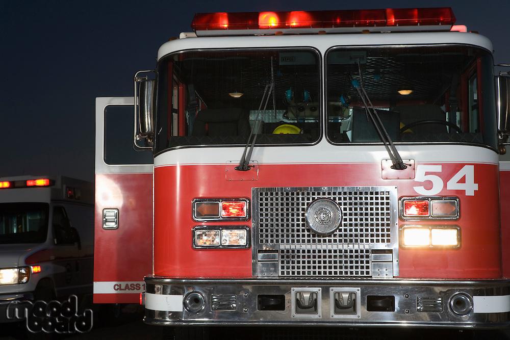 Fire engine and ambulance at night