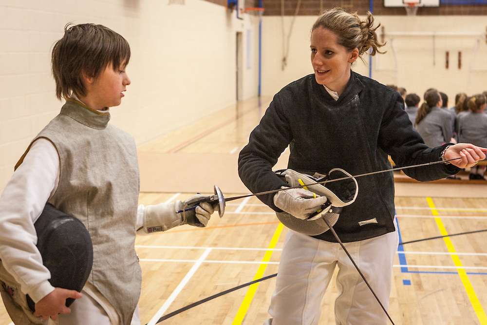 Corinna Lawrence, 2012 Olympic fencing hopeful helps Peter Jones.