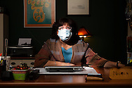 Nicole Kennelly, director of UNOCH, poses in her office. UNOCH has filed a lawsuit challenging the requirement that all staff at Rady Children's Hospital that have not gotten an H1N1 vaccination don face masks and an identifying badge.