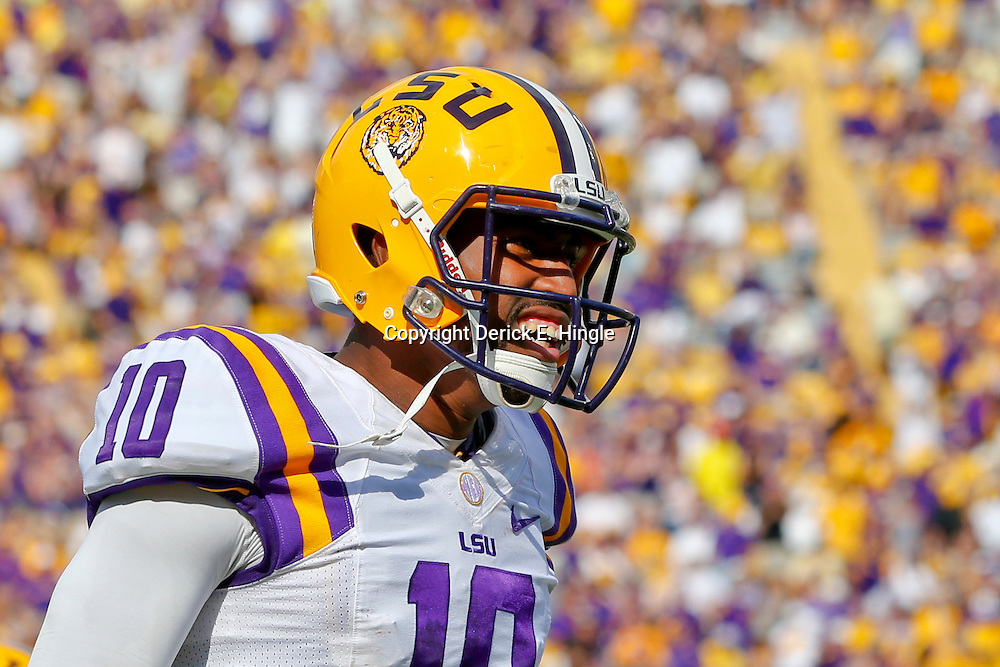 Oct 12, 2013; Baton Rouge, LA, USA; LSU Tigers quarterback Anthony Jennings (10) celebrates  after a touchdown against the Florida Gators during the first half of a game at Tiger Stadium. Mandatory Credit: Derick E. Hingle-USA TODAY Sports
