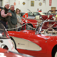 Bill Gregory and Mike Curtis, of Okolona, talk as they look at the 1957 Corvette that is on display at the Tupelo Automobile Museum during its final day open to the public. The two men have been many times before but wanted to come in for one last look while they had the chance.