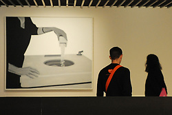 © Licensed to London News Pictures. 21/10/2013. London, UK. A couple view Machine On Laver by Peter Stampfli at the preview of The Pop Art Design Exhibition at The Barbican Centre. Photo credit : David Mirzoeff/LNP