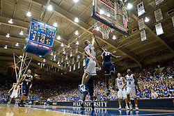 Virginia guard/forward Mamadi Diane (24) goes up for a rebound against Duke guard Jon Scheyer (30) at the end of the first half.  The Duke Blue Devils defeated the Virginia Cavaliers 87-65 in men's basketball at Cameron Indoor Stadium on the campus of Duke University in Durham, NC on January 13, 2008.