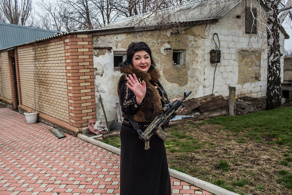 The head of the local administration holds a gun at a rebel military base on Saturday, March 26, 2016 in Dokuchaevsk, Ukraine.