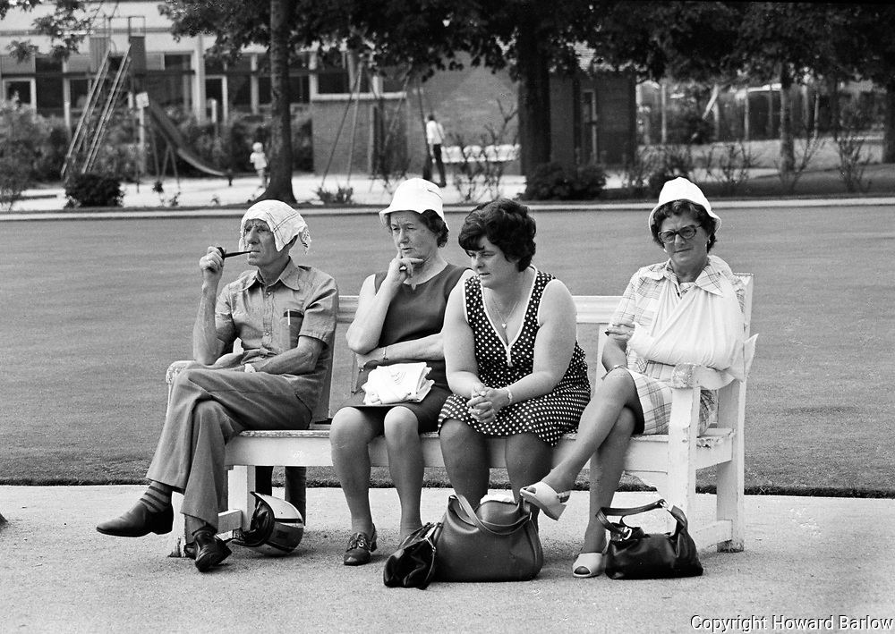 Watching the bowls in a Sale park - 1975<br /> I had gone along to the park to photograph the winners of the bowls tournament.<br /> These spectators were enjoying the summer sunshine, each one a study.