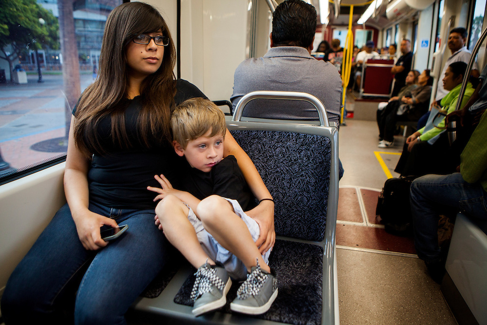 SAN DIEGO, CA - JULY 8, 2014:  Jannette Navarro and her son Gavin ride their second trolley of the day on the way to school and work, respectively. Navarro drops her son off at a daycare center before heading to her job at Starbucks Coffee in the Kearny Mesa neighborhood of San Diego. CREDIT: Sam Hodgson for The New York Times