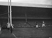 All Ireland Senior Football Championship Final, Kerry v Down, 25.09.1960, 09.25.1960, 25th September 1960, Down 2-10 Kerry 0-8,..Kerry goalie J Cullotty (left) saves a shot by P.Doherty (Down left half forward on the right), ..Referee J Dowling (Offaly),.Captain K Mussen,.