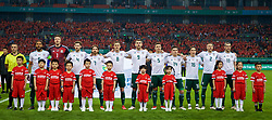 NANNING, CHINA - Thursday, March 22, 2018: Wales players sing the national anthem before the opening match of the 2018 Gree China Cup International Football Championship between China and Wales at the Guangxi Sports Centre. Captain Ashley Williams, goalkeeper Wayne Hennessey, Ben Davies, Joe Allen, Andy King, Sam Vokes, James Chester, Declan John, Harry Wilson, Chris Gunter, Gareth Bale. (Pic by David Rawcliffe/Propaganda)