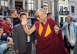 HUY, BELGIUM - MAY-30-2006 - The Dalai Lama greets children on the Grand Place of Huy before participating in a symposium with Belgium's top religious leaders. (PHOTO © JOCK FISTICK)