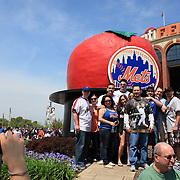 Fans take photographs in front of Citi Field, home of the New York Mets before the New York Mets V San Francisco Giants Baseball game at Citi Field, Queens, New York. 21st April 2012. Photo Tim Clayton