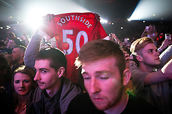 "© Licensed to London News Pictures . 06/11/2015 . Manchester , UK . Member of the watching audience raises a "" Southside 50 "" football shirt as American rapper 50 Cent ( Curtis James Jackson III ) performs at the Manchester Arena . Photo credit : Joel Goodman/LNP"