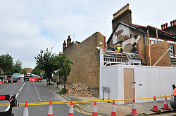 © Licensed to London News Pictures. 09/06/2016<br /> Lewisham collapsed house clean up begins.<br /> Builders have started clearing work on the terrace house in Lampmead Road,Lewisham that dramatically collapsed yesterday (08/06/16). <br /> <br /> <br /> <br /> (Byline:Grant Falvey/LNP)