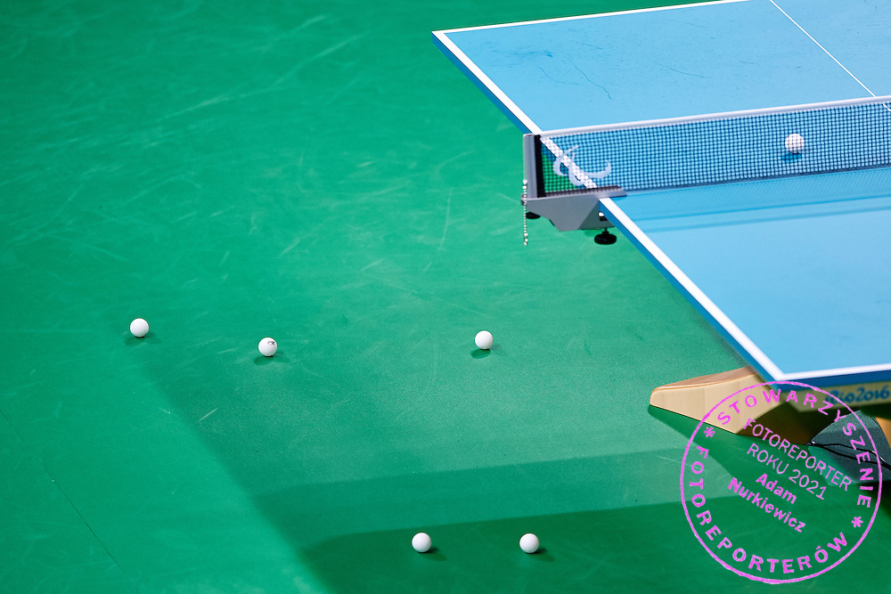 Rio de Janeiro, Brazil - 2016 September 03: Balls lie on the floor and the table during table tennis training session in Riocentro Pavilion 3 while 2016 Summer Paralympic Games on September 03, 2016 in Rio de Janeiro, Brazil.<br /> Rio 2016 Paralympic Games will be held from September 7 until 18.<br /> <br /> Adam Nurkiewicz declares that he has no rights to the image of people at the photographs of his authorship.<br /> <br /> Picture also available in RAW (NEF) or TIFF format on special request.<br /> <br /> Any editorial, commercial or promotional use requires written permission from the author of image.<br /> <br /> Mandatory credit:<br /> Photo by &copy; Adam Nurkiewicz / Mediasport