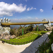 """Da Nang, Vietnam - October 31, 2018: Golden Bridge known as """"Hands of God"""", a pedestrian footpath lifted by two giant hands, open in July 2018 and a landmark at the famous tourist destination of Ba Na Hills in Da Nang, Vietnam."""