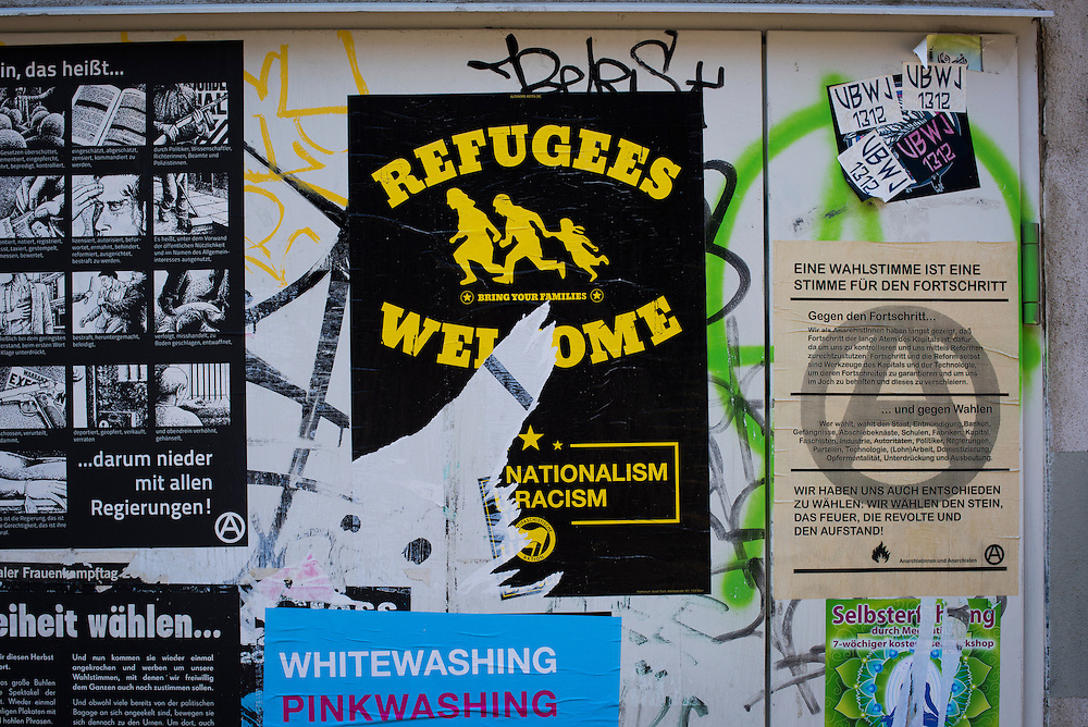 "A partially defaced ""Refugees Welcome"" poster is seen on September 22, 2015 in Vienna, Austria."