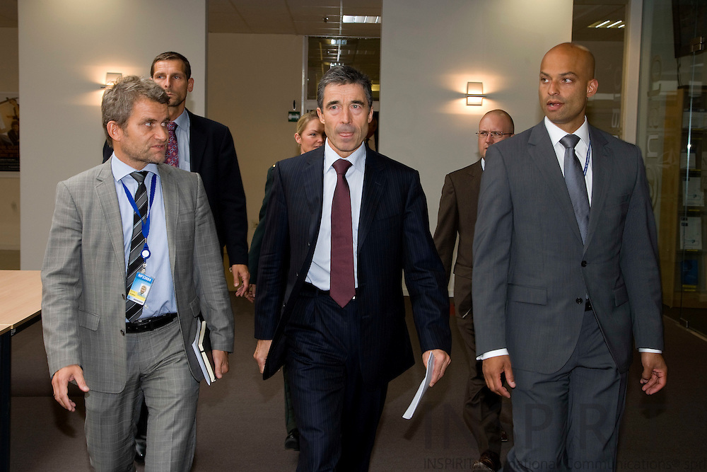 BRUSSELS - BELGIUM - 02 SEPTEMBER 2009 -- NATO Secretary General Anders Fogh Rasmussen walking to his first monthly Press Conference at NATO HQ with his Spin Doctor Michael Ulveman (left) and NATO spokesperson James Appathurai. Photo: Erik Luntang