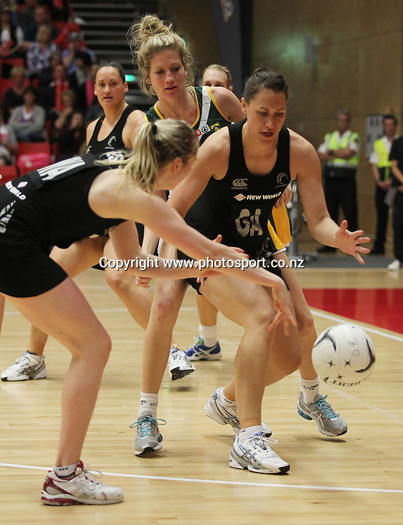 Silver Fern's Camilla Lees passes to Jodi Brown during the 2012 New World Quad Series. Silver Ferns v South Africa at Tect Arena, Tauranga, New Zealand on Sunday 28 October 2012. Photo: Mark McKeown / photosport.co.nz