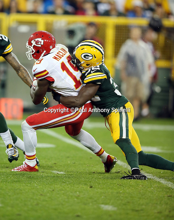 Kansas City Chiefs wide receiver Jeremy Maclin (19) gets tackled by Green Bay Packers strong safety Chris Banjo (32) as he runs with the ball on a third quarter reception good for a 31 yard gain and a first down during the 2015 NFL week 3 regular season football game against the Green Bay Packers on Monday, Sept. 28, 2015 in Green Bay, Wis. The Packers won the game 38-28. (©Paul Anthony Spinelli)