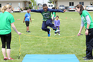 Matthew Williams (center), 9 of Winslow, New Jersey leaps over a line that Jessica Kendall (left), 26 of Moorestown, New Jersey and Megan Jean (right), 19, of Burlington, New Jersey hold during YMCA 'Healthy Kids Day'  Saturday April 30, 2016 in Mt. Laurel, New Jersey.  (Photo by William Thomas Cain)