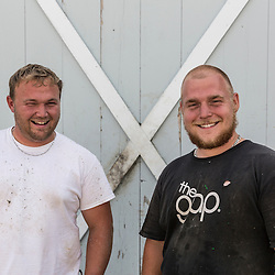 """Captain Richard Curtis (left) and sternman Isaiah Powell from the lobster boat """"Margaritaville"""" at the Friendship Lobster Co-op in Friendship, Maine."""