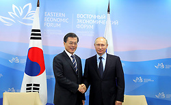 September 6, 2017 - Vladivostok, Primorye Territory, Russia - September 6, 2017. - Russia, Primorye Territory, Vladivostok. - Russian President Vladimir Putin and President of South Korea Moon Jae-in (left) during a meeting as part of the 3rd Eastern Economic Forum hosted by the Far Eastern Federal University, Russky Island. (Credit Image: © Russian Look via ZUMA Wire)