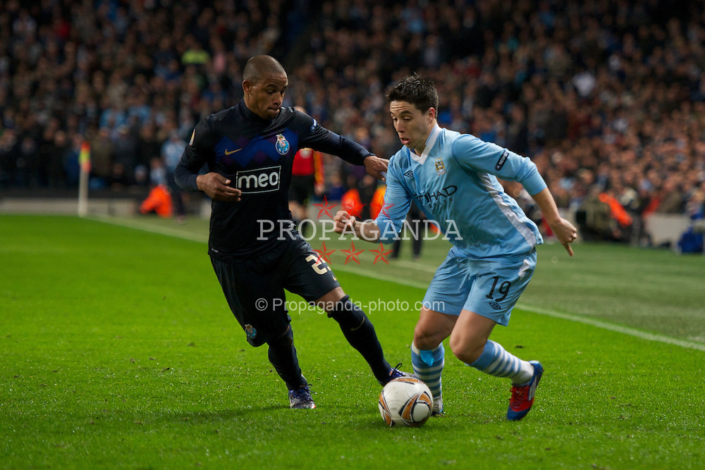 MANCHESTER, ENGLAND - Wednesday, February 22, 2012: Manchester City's Samir Nasri in action against FC Porto's Fernando during the UEFA Europa League Round of 32 2nd Leg match at City of Manchester Stadium. (Pic by David Rawcliffe/Propaganda)
