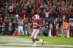 November 6, 2010; Stanford, CA, USA;  Stanford Cardinal running back Stepfan Taylor (33) scores a touchdown against the Arizona Wildcats during the fourth quarter at Stanford Stadium.  Stanford defeated Arizona 42-17.