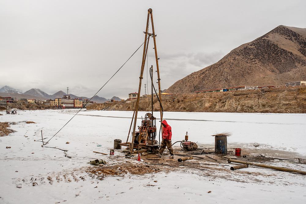 A drilling machine is set up on the frozen Mekong river in Zado, Tibet (Qinghai, China). Teams are tasking with taking earth samples from the river bed in preparation for the construction of a new bridge over the Mekong.