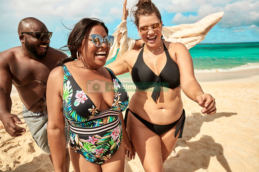 Plus-size model Ashley Graham and comedian Sherri Shepherd lead the pack in a new body-confident swimsuit campaign. The pair are seen flaunting their voluptuous figures in a colorful beach photoshoot in a collaboration between Swimsuits For All and KingSize. The collaboration between the size-inclusive women's swimwear brand and the men's big and tall brand are working together to create a cross-gender, body-positive message with the shoot featuring swimwear from both brands. TheEvery.Body.CountsSummer Campaign featuresGraham and Shepherd alongside Sports Illustrated modelTara Lynn, and plus size model,Emme. Joining the girls are male influencers Kelvin Davis,Bruce Sturgell,Zach Mikoandand Najee Fox! Graham said of the campaign: 'As thebody positive movement becomes more inclusive, and we continue to inspire women to love and embrace the skin that we're in, it is important that we invite everyone to join the conversation. 'We know that women's bodies are historically more judged and scrutinized, but we also recognize that men are subject to those pressures as well. This partnership shows our continued commitment to represent and celebrate different body types and sizes, supporting the confidence journey for everyone. Guys, we see you, too!' The swim campaign features both the Swimsuits For All and KingSize summer 2019 collections, both available on the respective brand's websites. The KingSize collection is available in men's sizes BIG XL-9X and TALL L-6XL, and the Swimsuits For All collection features women's sizes 4-40. 13 May 2019 Pictured: Ashley Graham stars alongside Sherri Shepherd, Tara Lynn, Emme, Kelvin Davis,Bruce Sturgell,Zach Mikoand and Najee Fox in the Every.Body.CountsSummer Campaign collaboration between Swimsuits For All and KingSize. Photo credit: Swimsuits For All/ KingSize/MEGA TheMegaAgency.com +1 888 505 6342