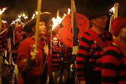 © Licensed to London News Pictures. 05/11/2015. Lewes, UK. Bonfire societies parade through the streets of Lewes in Sussex during the traditional Bonfire Night celebrations on Thursday, 5 November, 2015. Thousands of people attend the parade through the narrow streets of Lewes and burn effigies to celebrate Guy Fawke night. Photo credit: Tolga Akmen/LNP