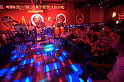 Sanlitun bar street nightlife district. Live music at Red Moon Club.