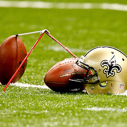 September 9, 2012; New Orleans, LA, USA; A New Orleans Saints helmet and footballs on the field prior to kickoff of a game against the Washington Redskins at the Mercedes-Benz Superdome. Mandatory Credit: Derick E. Hingle-US PRESSWIRE