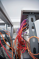Multicolored data cable connected to computer network in server room