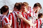 Cheltenham captain Kyle Storer celebrates with Danny Wright during the Vanarama National League match between Cheltenham Town and Boreham Wood at Whaddon Road, Cheltenham, England on 25 March 2016. Photo by Carl Hewlett.