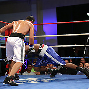 "Moises Hernandez (white shorts) beats Asaac Smith during a ""Boxeo Telemundo""  boxing match at the Kissimmee Civic Center on Friday, July 18, 2014 in Kissimmee, Florida.  (AP Photo/Alex Menendez)"