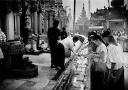 Lighting 10,000 candles at Shwedagon Pagoda, Yangon, Burma.