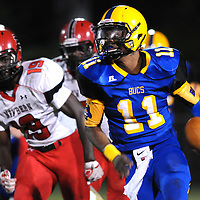 Laney High School's Tarik Lane rushes past New Bern High School's Cypress Borden Friday September 19, 2014. (Jason A. Frizzelle)