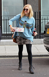Pregnant DJ/Presenter Fearne Cotton carrying a cake tin and a bottle of coke arriving at BBC Radio 1 in central London, UK. 03/09/2012<br />BYLINE MUST READ : GOTCHAIMAGES.COM<br /><br />Copyright by © Gotcha Images Ltd. All rights reserved.<br />Usage of this image is conditional upon the acceptance <br />of Gotcha Images Ltd, terms and conditions available at<br />www.gotchaimages.com