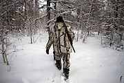 Hunter in the Yakutian Taiga a few hundred kilometers from the city of Yakutsk. Yakutsk (Russian: ???????) is a city in the Russian Far East, located about 4° (450 kilometres) south of the Arctic Circle. It is the capital of the Sakha (Yakutia) Republic in Russia with a major port on the Lena River. The city has a population of 264.000 (2009). Yakutsk is one of the coldest cities on Earth. The average monthly winter temperature in January is around -43,2 °C. Yakutsk, Jakutsk, Yakutia, Russian Federation, Russia, RUS, 24.01.2010.
