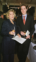 SUSAN, VISCOUNTESS HEREFORD and her son the HON.ROBIN DEVEREUX,  at an exhibition in London on 23rd February 1999.MOP 29