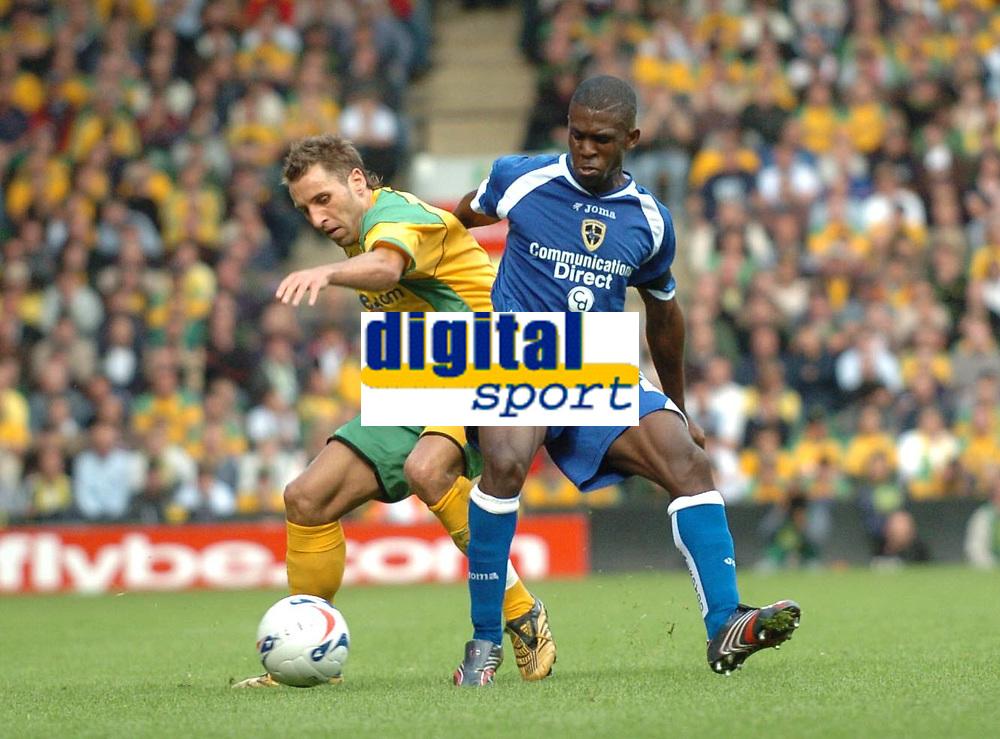 Photo: Ashley Pickering.<br />Norwich City v Cardiff City. Coca Cola Championship. 21/10/2006.<br />Cardiff's Malvin Camara and Norwich's Darren Huckerby.