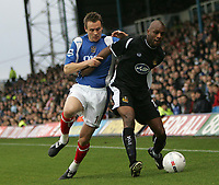 Photo: Lee Earle.<br /> Portsmouth v Wigan Athletic. The FA Cup. 06/01/2007.Portsmouth's Mathew Taylor (L) battles with Emmerson Boyce.