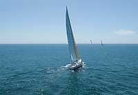 Sailboat racing on Ocean back view