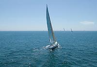 Sailboat racing on Ocean back view