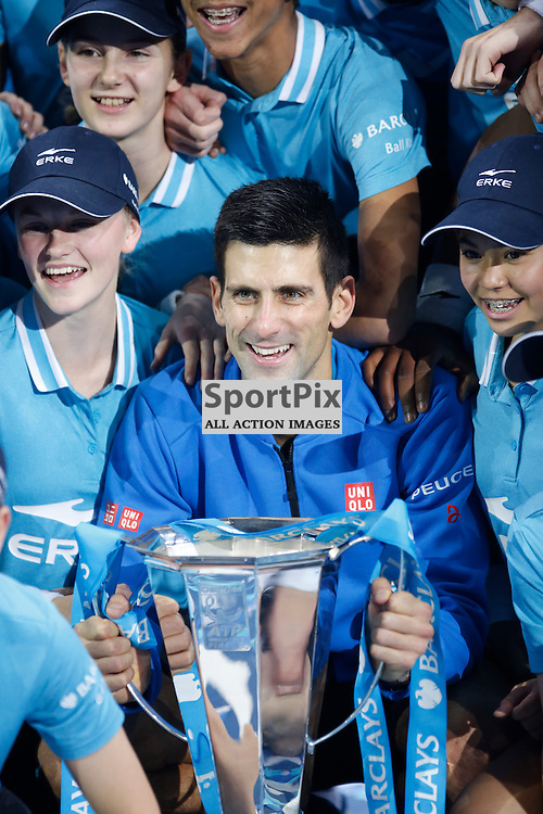 Novak Djokovic holds the trophy for winning the ATP World Tour Final match between Novak Djokovic and Roger Federer at the O2 Arena, London 2015.  on November 22, 2015 in London, England. (Credit: SAM TODD | SportPix.org.uk)