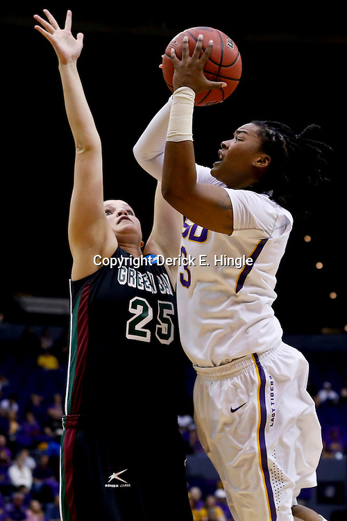 Mar 24, 2013; Baton Rouge, LA, USA; LSU Tigers guard Bianca Lutley (3) shoots over Green Bay Phoenix forward Jenny Gilbertson (25) in the first half of the first round of the 2013 NCAA womens basketball tournament at the Pete Maravich Assembly Center.  Mandatory Credit: Derick E. Hingle-USA TODAY Sports