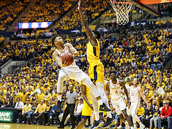 Jan 20, 2018; Morgantown, WV, USA; Texas Longhorns guard Eric Davis Jr. (10) shoots in the lane during the first half against the West Virginia Mountaineers at WVU Coliseum. Mandatory Credit: Ben Queen-USA TODAY Sports